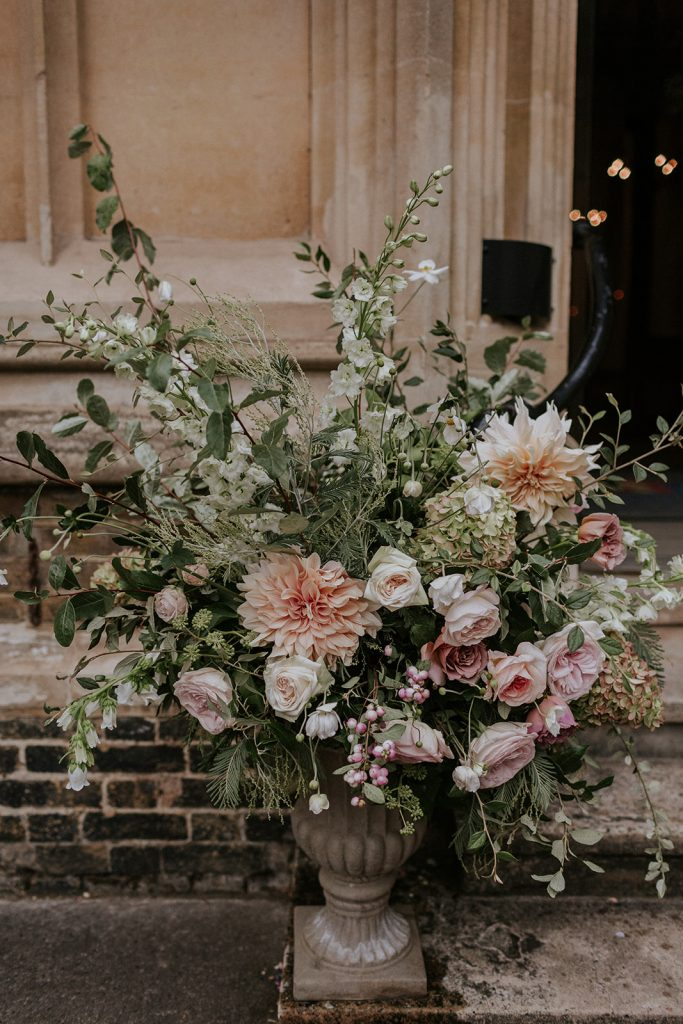 Natural romantic church urn with garden roses